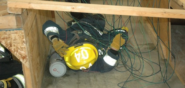 Firefighter training includes learning how to navigate confined spaces in full gear (Photo: HLOB Fire Department)