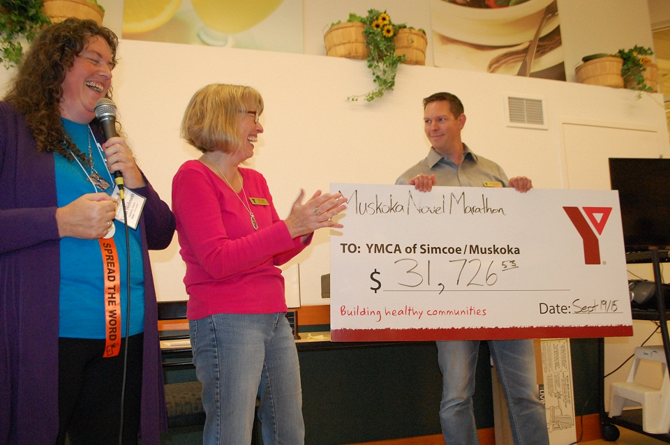 Nancy West, centre, reacts to the amount raised at the 2015 Muskoka Novel Marathon, with Karen Wehrstein and Andrew Lorriman
