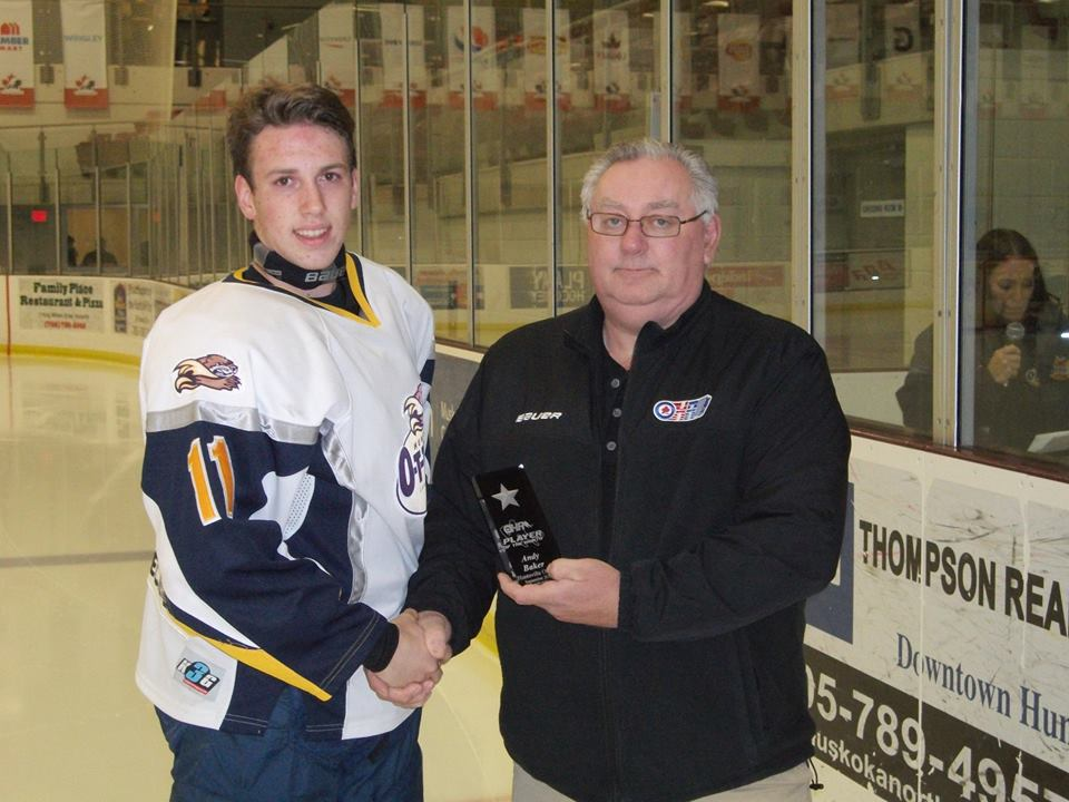 Larry Cowan of the OHA was on hand to present the Otter's Andy Baker with the Player of the Month Award before a 6-2 victory over the Midland Flyers