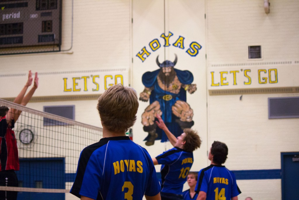 Bronson Boyko (#3, left) and Brodie Smith (#14, right) watch Ethan Murdy (#10, centre) smash a ball over the net