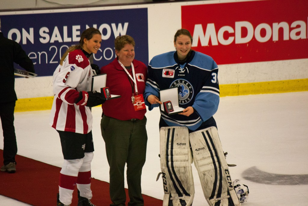 Anonda Hoppner (Ontario Red, left) and Édith D'Astous-Moreau (Quebec, right) receive Player of the Game honours on Wednesday night
