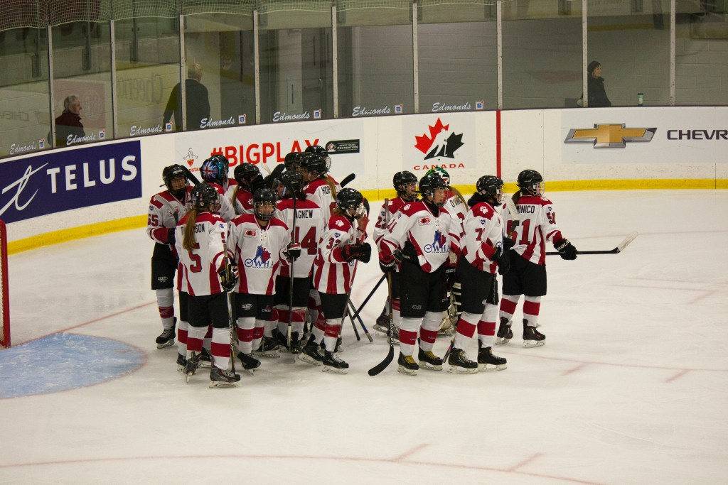 Ontario Red celebrates a tense opening night victory as they hang on to defeat Quebec by a score of 2-1