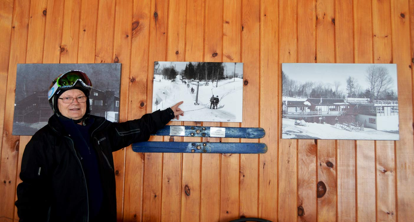 Ken Farnsworth worked at Hidden Valley for 30 years and saw a lot of change over the course of those years. Here he points to a photo of the day when there wasn't yet chairlifts and people were towed up a hill.