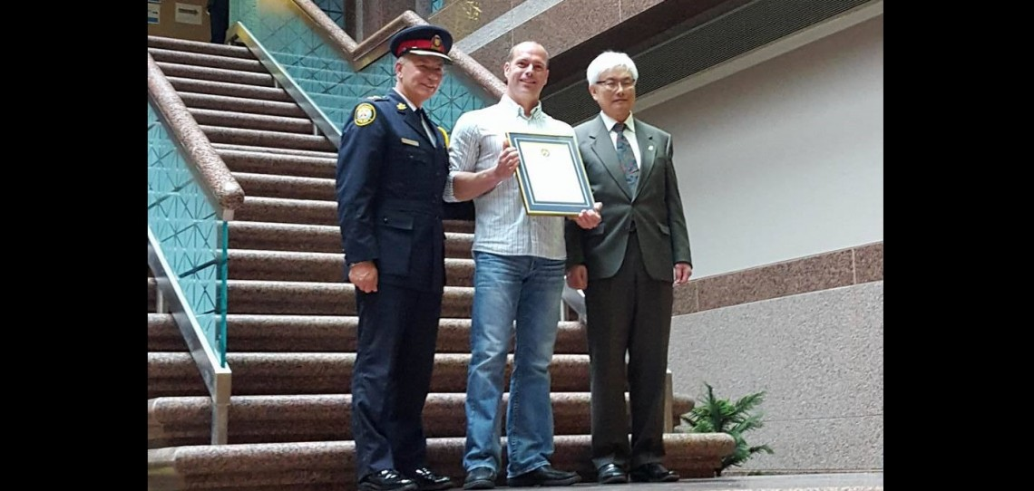Randy Blain with Councillor Chin Lee (right), Acting Chair of the Toronto Police Services Board and Toronto Police Services Acting Deputy Chief Richard Stubbings (supplied photo)