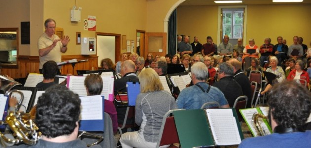 Neil Barlow directs a rehearsal of the Muskoka Concert Band while the Canada 150 choir listens