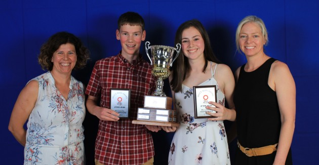 Catherine Smith (far left) and Tara Schmidtke (far right) present Owen Johnstone and Celeste Dupuis with the male and female junior True Sport Awards