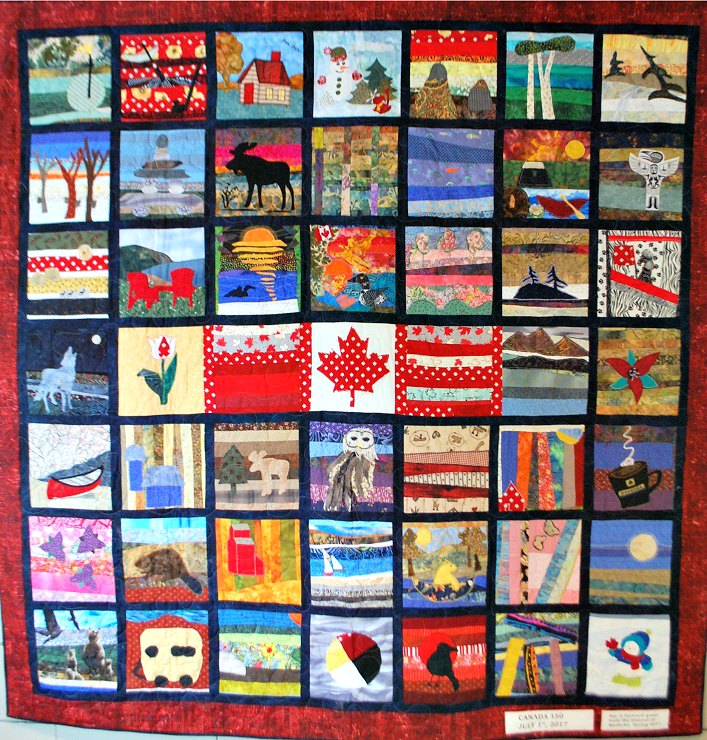 A special Canada 150 quilt, created by community members, on display in Town Hall