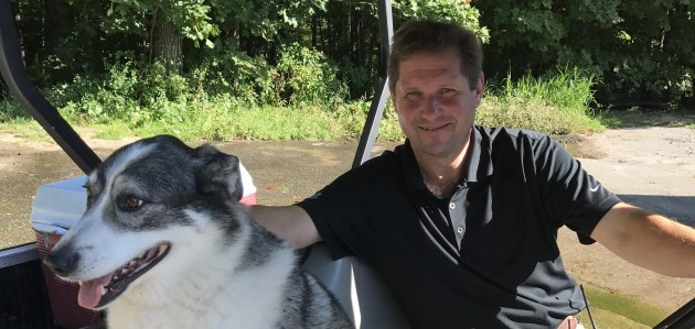 Keith Walton and his dog Wally, about to check on the links at Grandview's Mark O'Meara course