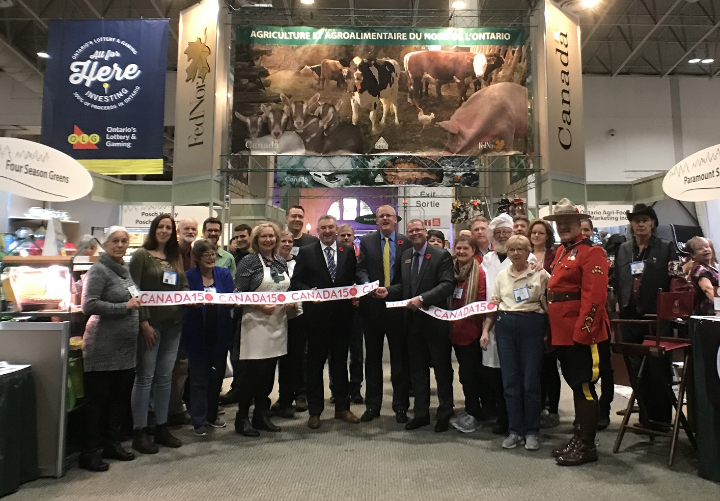 Exhibitors from across Northern Ontario, including Steve Bacon of Four Season Greens and Matt Richter of Best Ever Food (back row, at left) joined Guy Paquette of FedNor and representatives of Toronto's Royal Agricultural Winter Fair to officially open the FedNor-supported Northern Ontario Pavilion. (Photo: edNor)