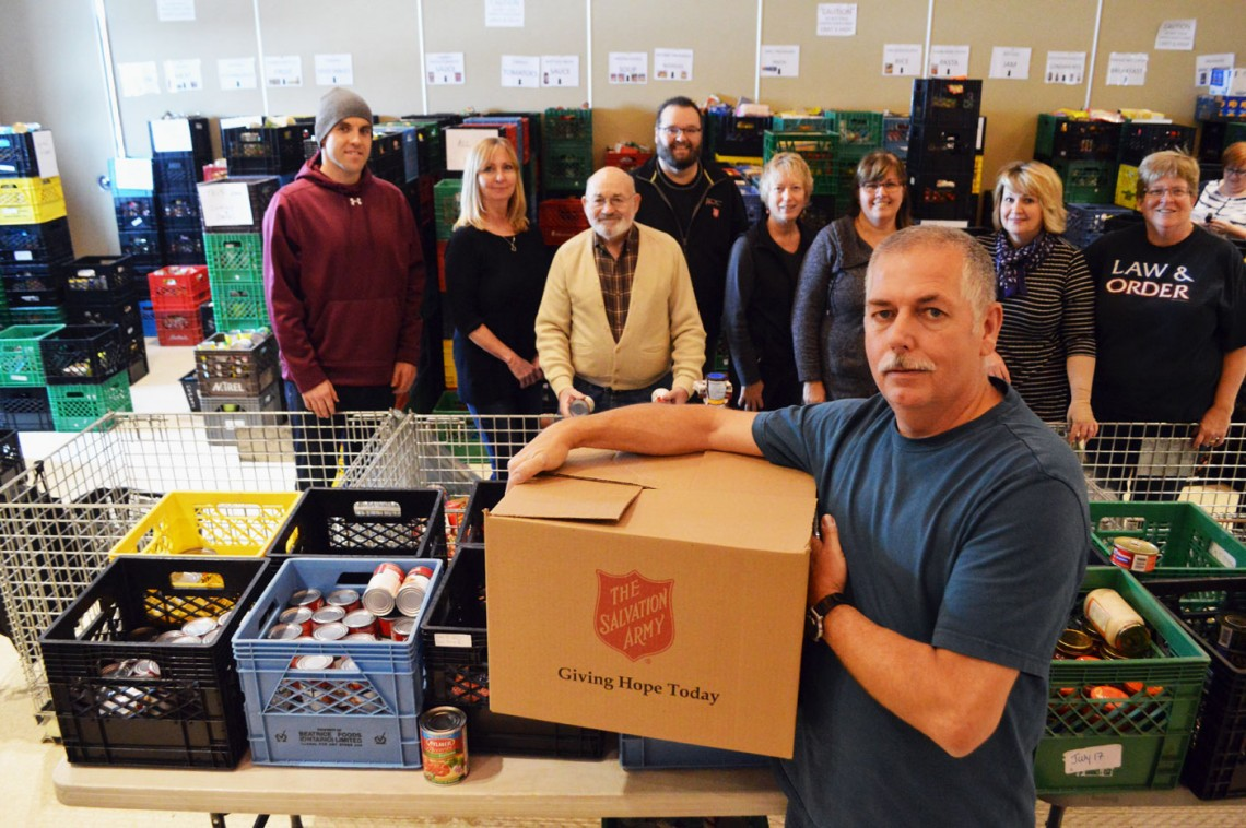 Ralph Gibson (front) leads a team of amazing volunteers who help organize the Salvation Army's Christmas hampers.