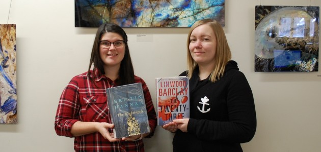 Cortney LeGros (left) and Julie Manczak with two of HPL's top 10 books of 2017