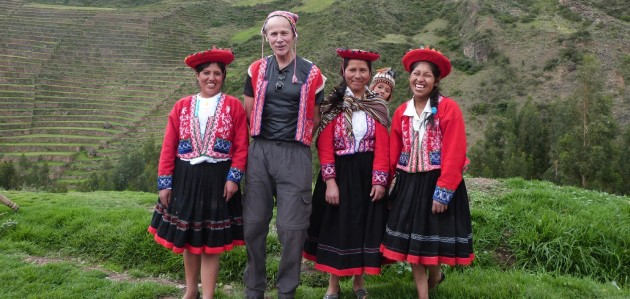 Dave McGuey (second from left) in Peru with women in traditional dress (Photo courtesy of Dave McGuey)