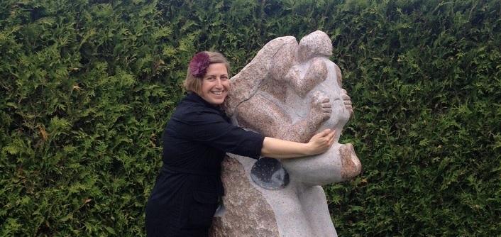 Elise Muller hugs her sculpture Attunement (Photo courtesy of Elise Muller)