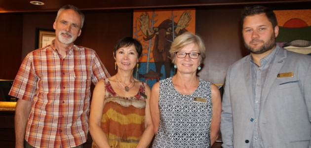 (From left) John Ovcacik, winner of the Algonquin 125th Birthday Art Contest, is congratulated by Eclipse Gallery manager Karin Kriekaard, Deerhurst Resort Director of Marketing Laura Kennedy and General Manager Jesse Hamilton.