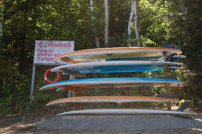 SUPs await renters at Beach 2 on Arrowhead Lake