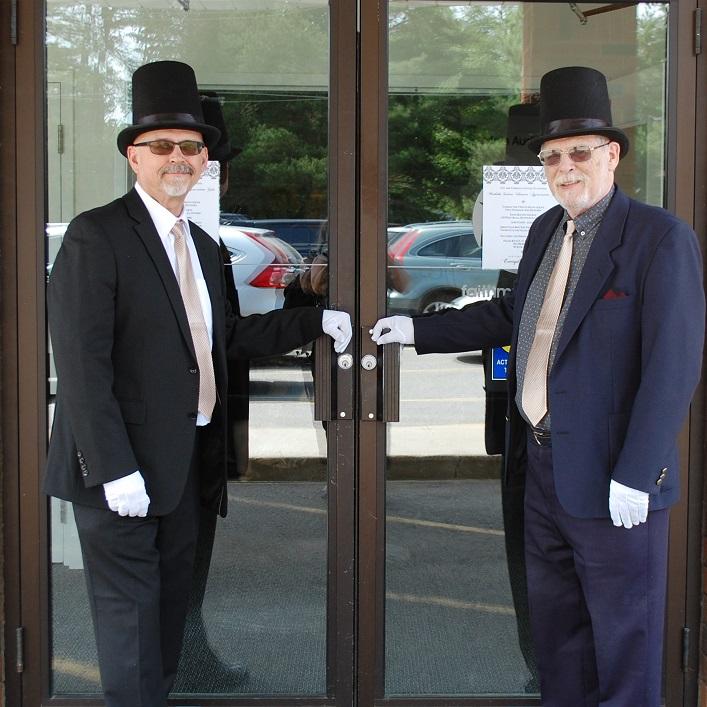 Ron Nairn (left) and Frank Jones greet volunteers in style
