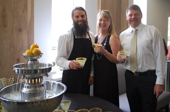 Steve Nairn (left) serves up lemonade to volunteers Glenna and Dan Armour