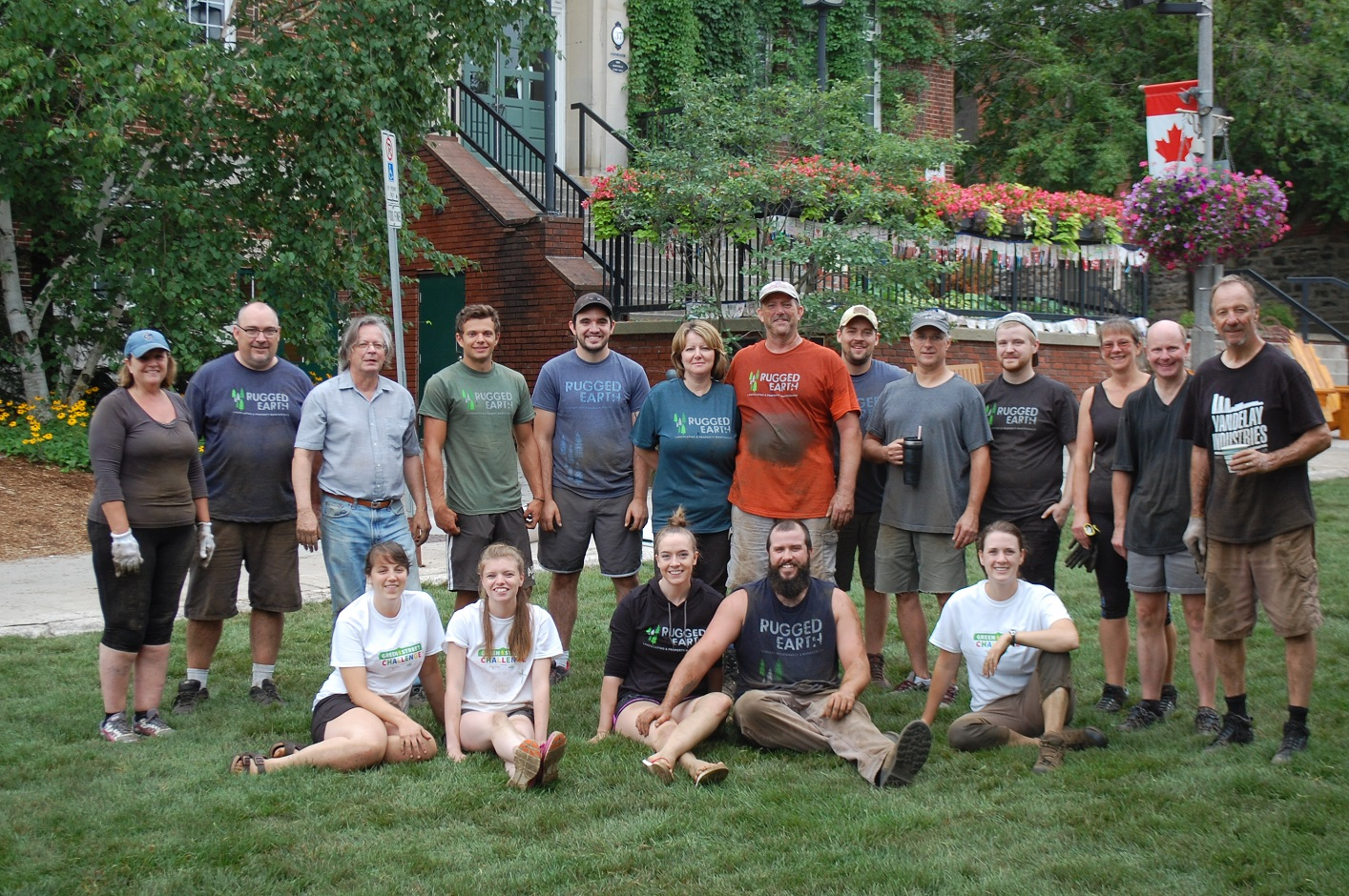 Volunteer sod-layers relax after a job well done for the 2018 Green Street Challenge