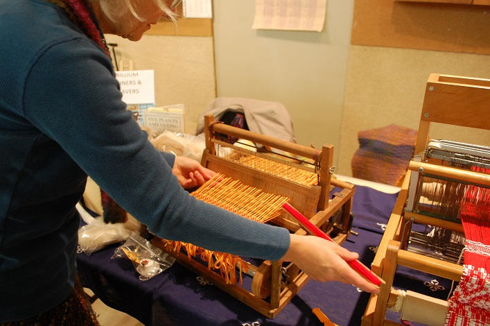 Margaret Penner demonstrates how to use a tabletop loom