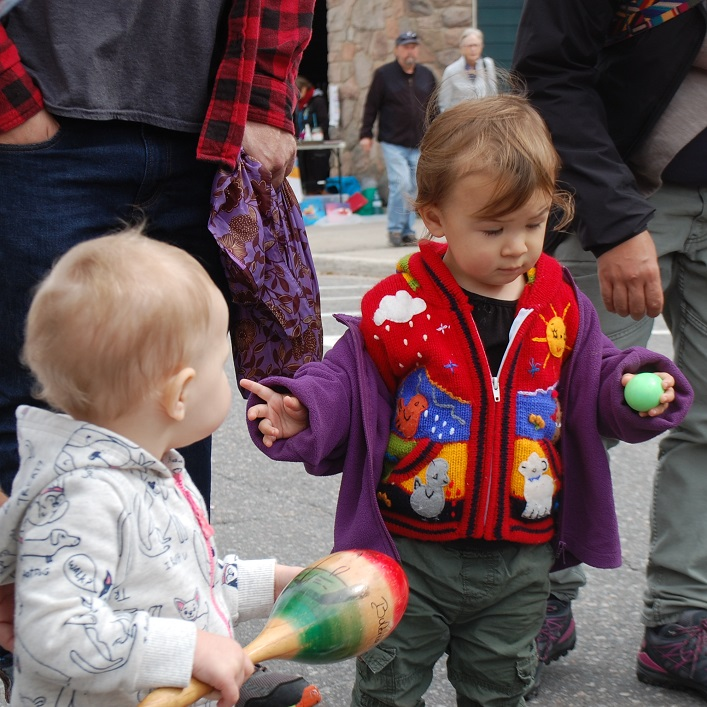 Henley Stroud (left), 15 months, and Ember Krug, 22 months, find some rhythm with instruments from Barry 'Bazza' Hayward