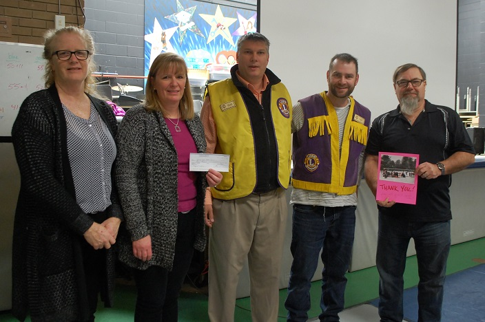 (From left) Spruce Glen principal Kelly Picken and parent volunteer Shannon Lockwood accept a cheque from Huntsville Lions Club president Mark Urbanski, vice president Casey Noble and treasurer Bob MacDonald
