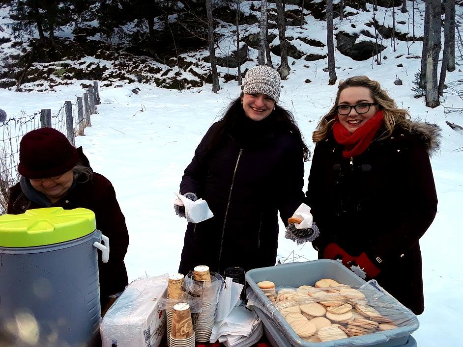 Santa's helpers serve hot chocolate and cookies