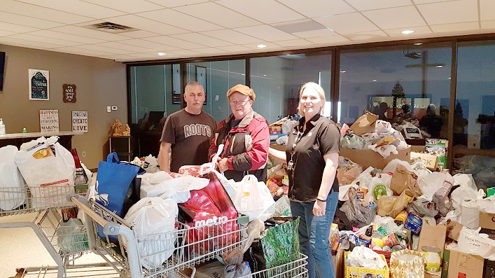 (From left) Lead volunteer Ralph Gibson, volunteer Gord Swan, and Salvation Army Community Ministries Coordinator Krystal Fuller continue sorting donations the day after the 30th annual Project Porchlight