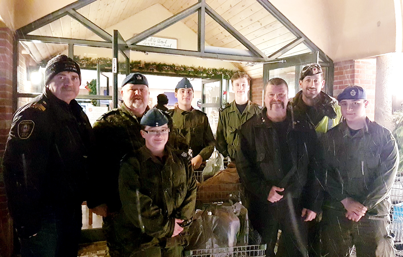 Firefighters and cadets play a big role in the food drive effort, including (from left) Huntsville Fire Chief Steve Hernen, Captain Adam Smith, Warrant Officer 2nd Class Emily Cain, Cpl Charlie Fraser, Cpl Evan Scholten, District Chief Brady Corry, Civilian Instructor Derek Mossman, and Warrant Officer 1st Class Matthew Sutey