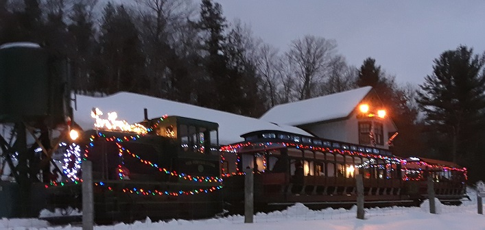 The Portage Flyer is festively lit for its annual, magical trip to Santa's cabin