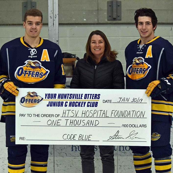 (From left) Cody Jones, Trish Kruusmagi from the Huntsville Hospital Foundation, and Tyler Gervais-Rolfe