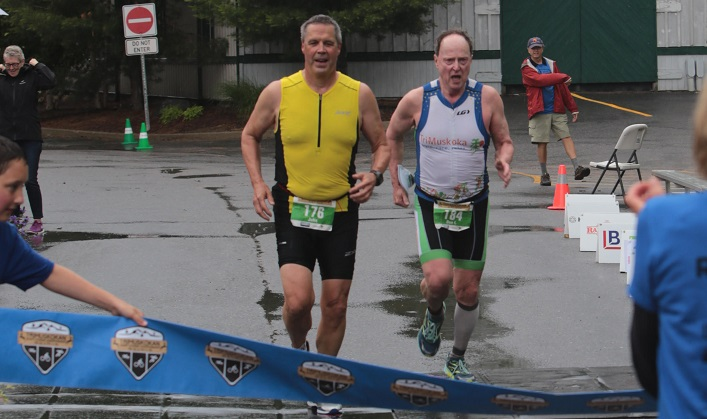 Don McCormick (right) at the finish line of the 2017 TriMuskokan (Photo: Jamie McCormick)
