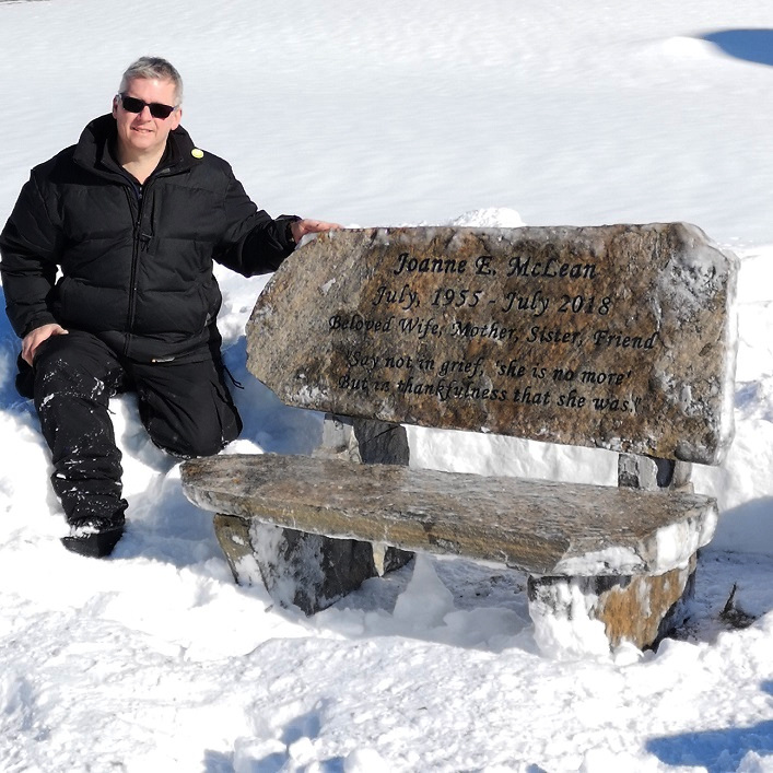 David McLean with the stone bench honouring his wife Joanne