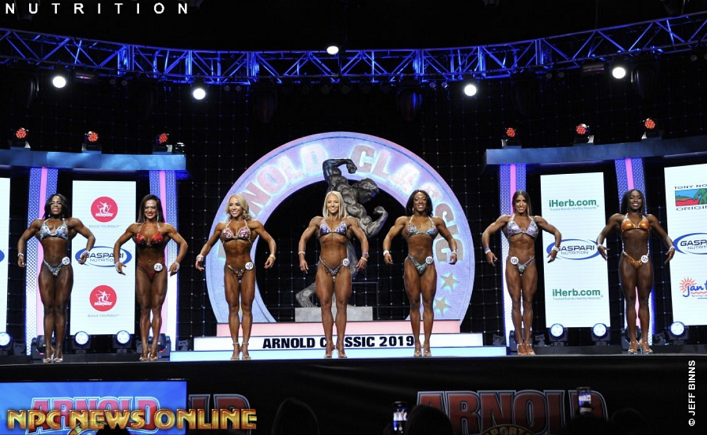 Angie Aldridge (centre) on stage at the 2019 Arnold Classic (supplied)