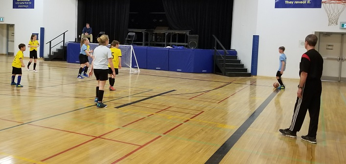 The U13 Division's Team Yellow went undefeated at the indoor league's end-of-season tournament