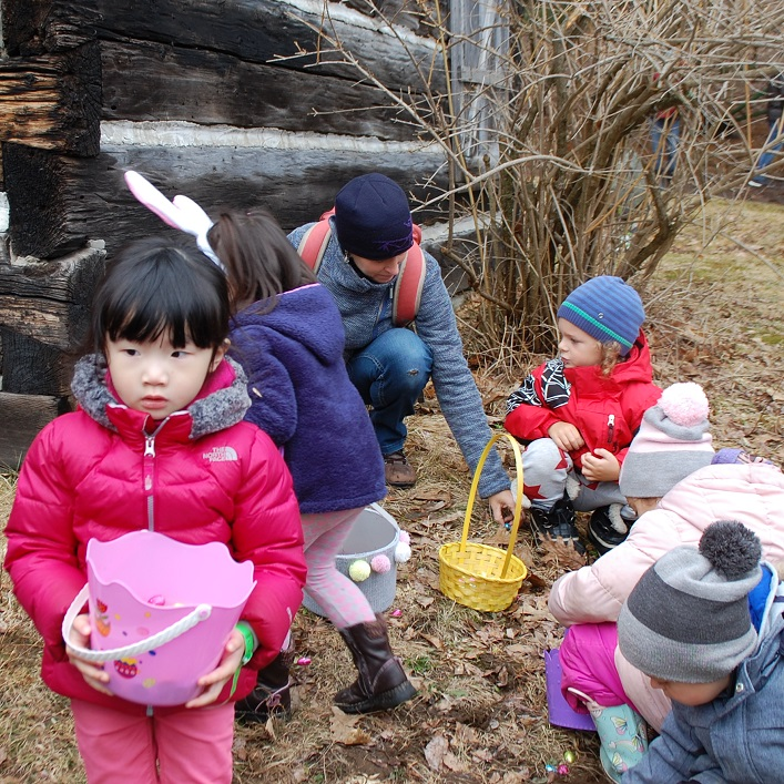 The pioneer village was divided into sections for he egg hunt. Here, the three to four-year-olds scoop up eggs as quickly as they can.