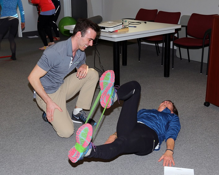 Chiropractor Matt Diston (left) gives Monique Charlton some pointers (supplied)