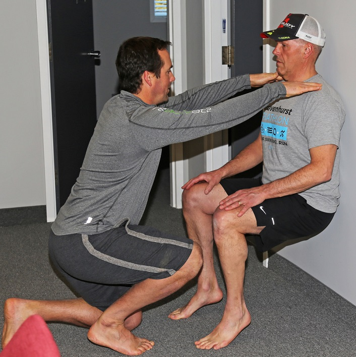 Dr. Rich Trenholm (left) guides Russ Buckerfield in an exercise