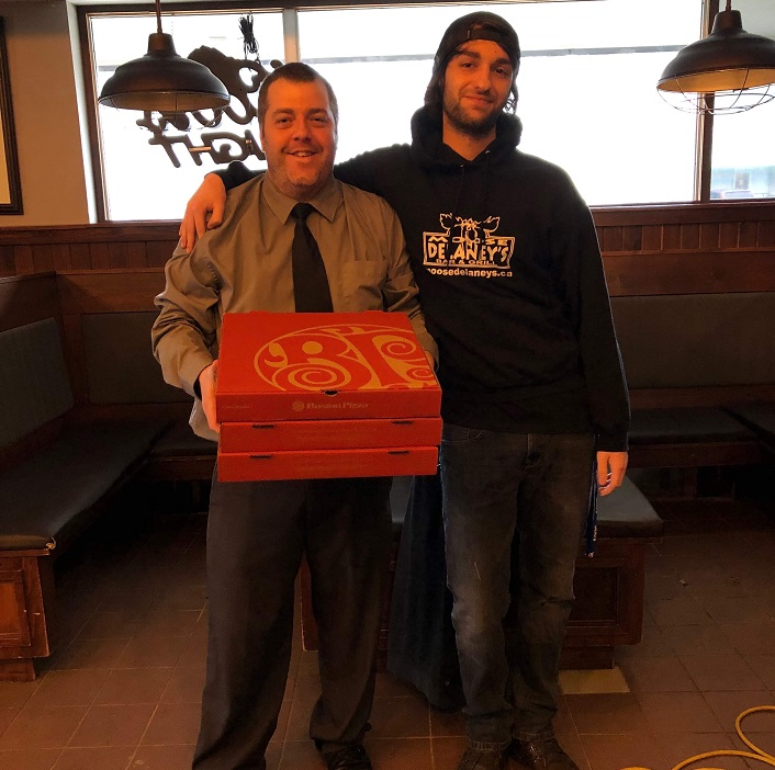 Mmmmm...pizza. Staff at Moose Delaney's appreciated the gesture when Boston Pizza brought them food to keep them going during their clean up. (supplied)