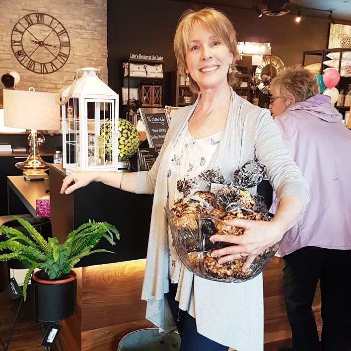 Suzanne Baxter greeted everyone with a basket of caramel corn and discount cards for items in the showroom