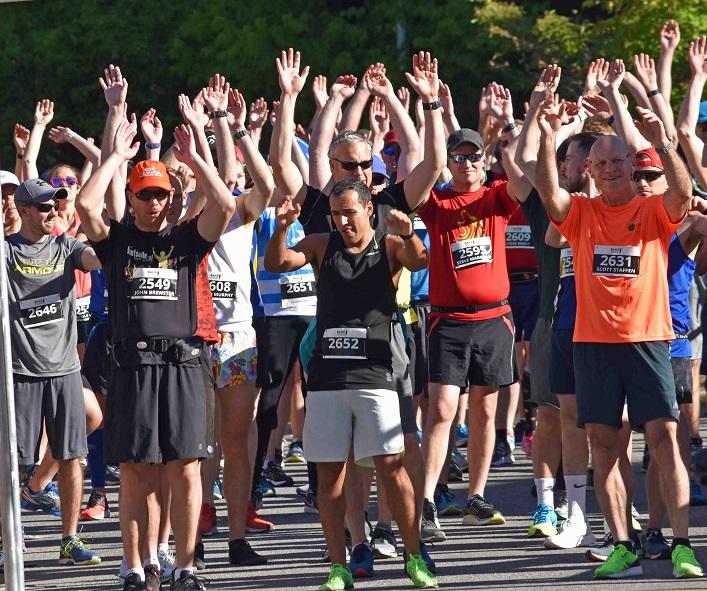 Can we get a wave? Runners await the start of half marathon