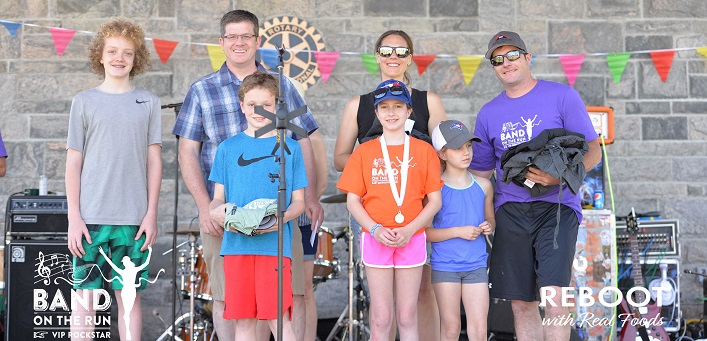 Gabe and Sam Holinshead Farnsworth (front left) continue to honour their mom Jody at BOTR every year (supplied)