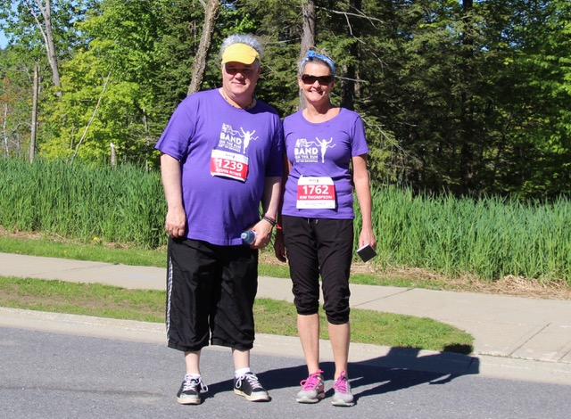 Kevin Rows (left) and Kim Thompson walking in support of Community Living Huntsville (Photo: Liz Rice)