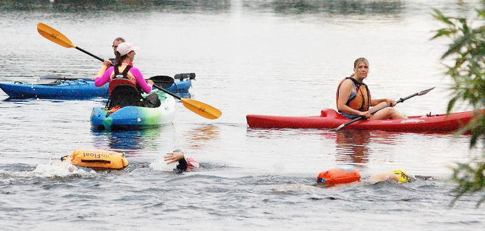 Volunteer spotters in kayaks helped ensure swimmers were safe
