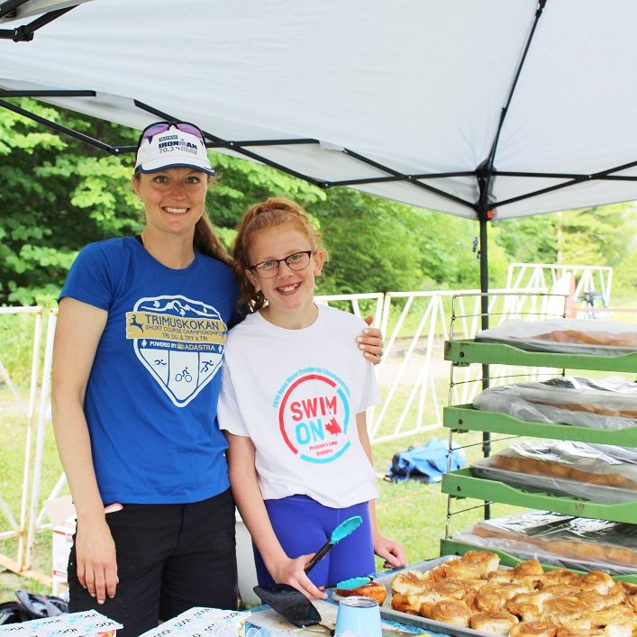 Volunteers Carolyn Croxall and Hayley Oke serve up a continental breakfast courtesy of Henrietta's Pine Bakery, Bullock's Your Independent Grocer, and Inspire Coffee Roasting Co.