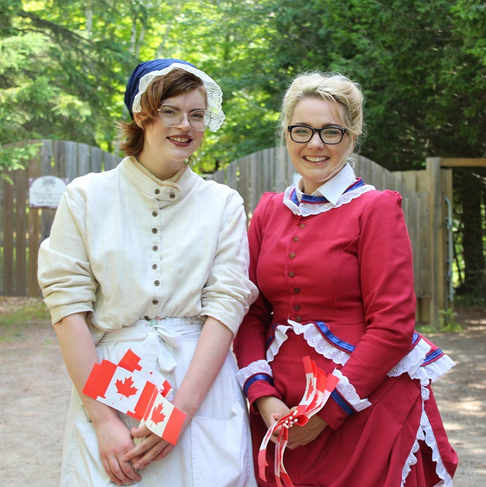 Catherine Bergs and Erica Cole welcome visitors to the 1890s