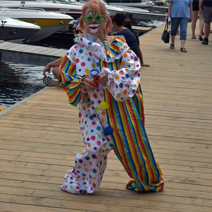Gizmo the clown tested out the course and gave the crowd a squirt or two