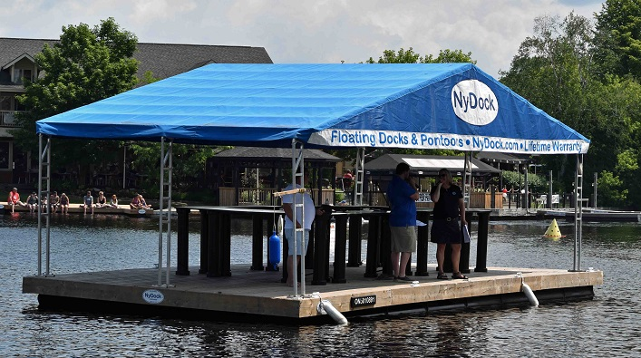 The Rotary Dockfest announcers had a close-up view of the course on the NyDock floating dock