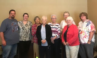 Laura Veenstra (second from left) with her husband and Canadian Cancer Society volunteers (supplied)