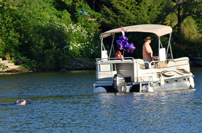 Joy's support boat leads her up the Muskoka River
