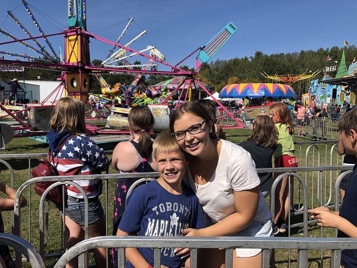 Landon Peters and his sister Amber Clarke waiting for his favourite ride at the fair